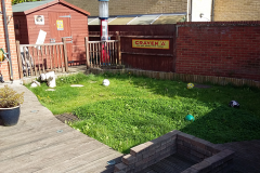 Fossil sandstone & artificial grass Before
